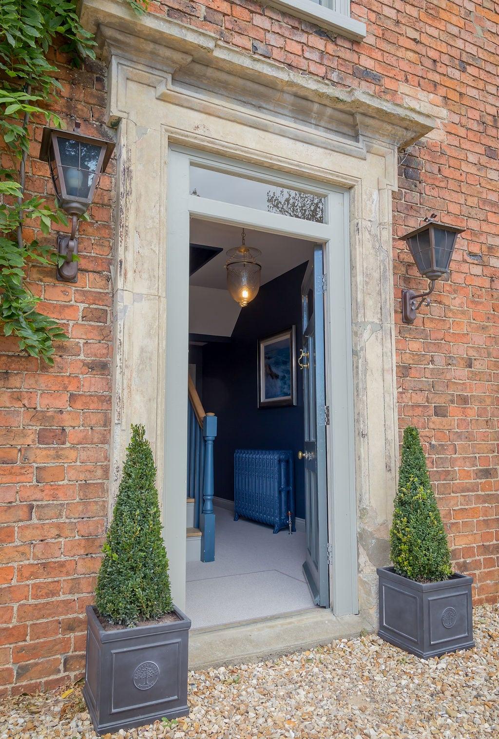 Old Blue Cast IronRadiatorThrough Doorway